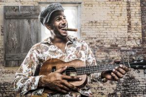 Cuban musician playing song and smoking cigar